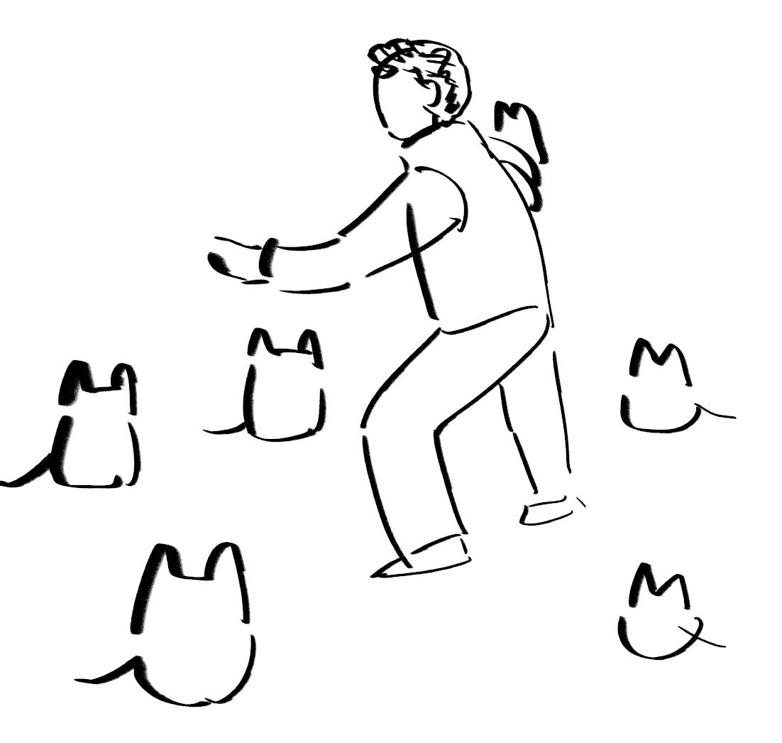 猫に囲まれる司会のおっちゃん